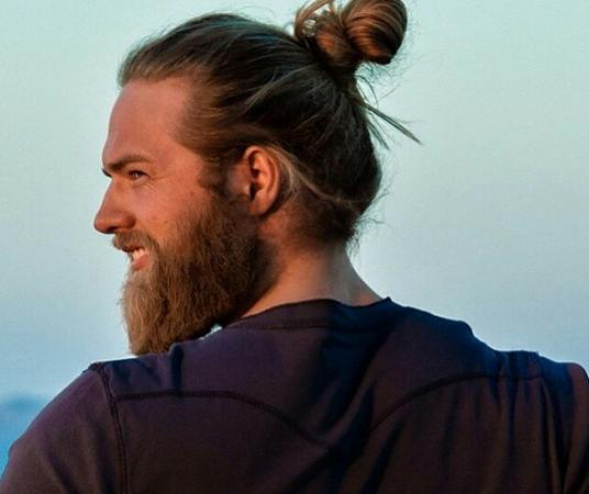 A-hipster-with-a-shaggy-beard-and-a-full-man-bun-hair-style