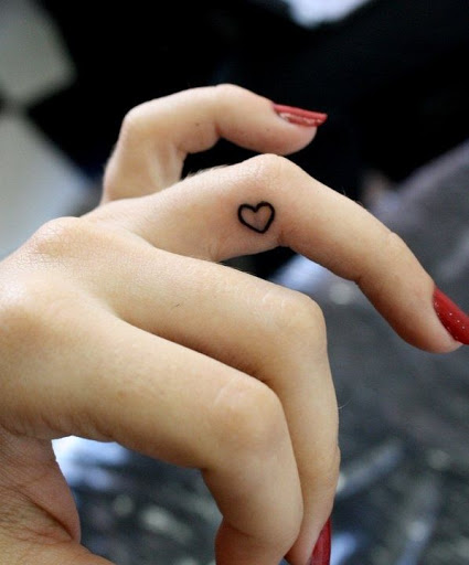Small cute heart tattoos designs on the ring finger