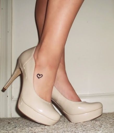 Small heart tattoo design on ankle for women